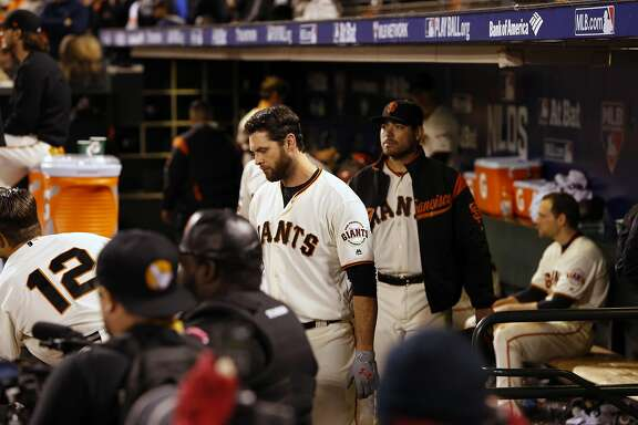 Inside the Giants' dugout players head for the locker room including Brandon Belt, after the San Francisco Giants fell to the Chicago Cubs 6-5 in game 4 of the National League Division Series at AT&T Park on Tuesday October, 11  2016, in San Francisco, California.