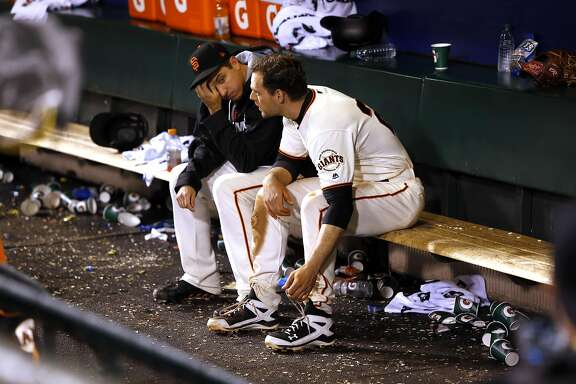 Giants' Derek Law, (left) and Conor Gillespie inside the Giants' dugout after the San Francisco Giants fell to the Chicago Cubs 6-5 in game 4 of the National League Division Series at AT&T Park on Tuesday October, 11  2016, in San Francisco, California.