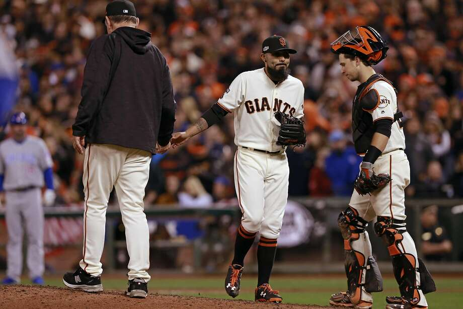 Sergio Romo hands the ball to manager Bruce Bochy and leaves the mound for what would be the last time as a Giant in October. Romo gave up a run-scoring double to the Cubs' Ben Zobrist during a ninth-inning bullpen meltdown in Game 4 of the NLDS against Chicago. Photo: Michael Macor, The Chronicle