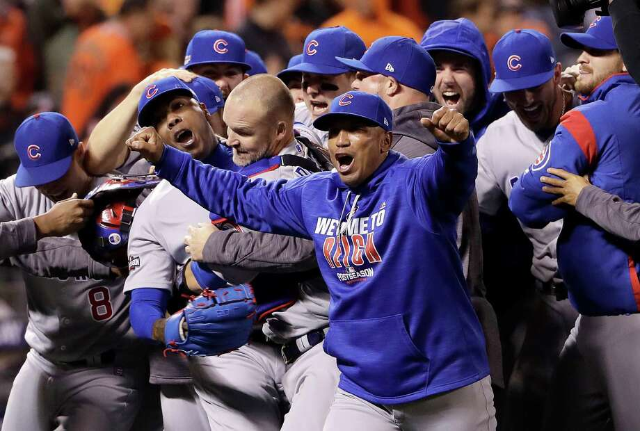 After striking out the Giants in order in the ninth, reliever Aroldis Chapman, second from left, catcher David Ross and the rest of the Cubs celebrate their good fortune - a dramatic victory and a berth in the NLCS. Photo: Marcio Jose Sanchez, STF / Copyright 2016 The Associated Press. All rights reserved.