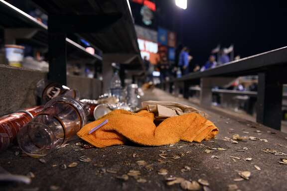 A Giants orange towel sits in the ground in the bleacher section after the Cubs won game 4 of the National League Division Series between the Chicago Cubs and the San Francisco Giants at AT&T Park in San Francisco, CA Tuesday, October 11, 2016.