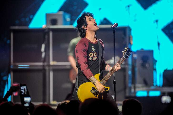 FILE - In this Sept. 21, 2012 file photo, Billie Joe Armstrong of Green Day performs at the iHeart Radio Music Festival at the MGM Grand Arena in Las Vegas. Green Day has postponed the first three dates of its upcoming tour and canceled a fourth show due to illness, the band announced Sunday, Sept. 18, 2016. Concerts will be rescheduled in St. Louis, Chicago and Detroit, and a fourth concert in Toronto is being canceled. (Photo by Eric Reed/Invision/AP, File)