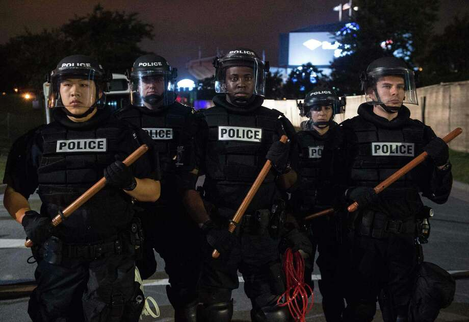"""A Quinnipiac Unviversity poll, released on Wednesday, Oct. 12, 2016, found a total of 72 percent of all Americans say police brutality is a """"very serious"""" or """"somewhat serious"""" problem. A total of 95 percent of black adults say police brutality is a """"very serious"""" or """"somewhat serious"""" problem. A total of 66 percent of whites say it's """"very serious"""" or """"somewhat serious."""" Photo: NICHOLAS KAMM / AFP /Getty Images / AFP or licensors"""