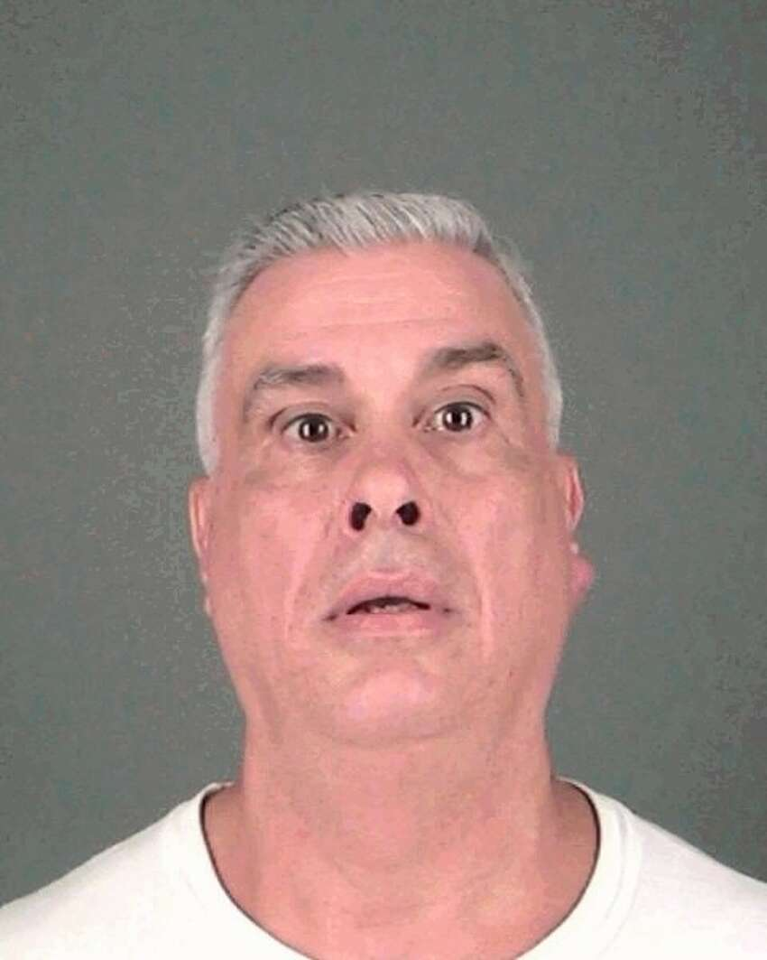 Albany resident Todd M. Warnken, 55, allegedly threatened to beat a black woman and called her racial slurs after being kicked out of a grocery store Monday night. (Albany Police Department)