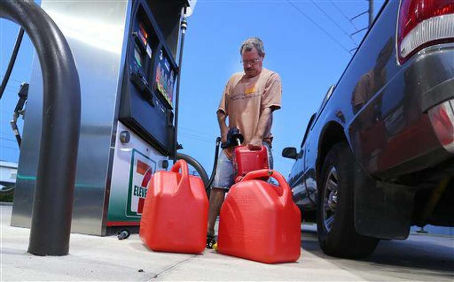 Jeff Beebe, of Cape Canaveral, Fla., fills gasoline containers, to be later used for his generator, Wednesday, Oct. 5, 2016, as Hurricane Matthew approaches Florida. Beebe is evacuating his home along with his 80 year old parents to Orlando. (Red Huber/Orlando Sentinel via AP) Photo: Red Huber