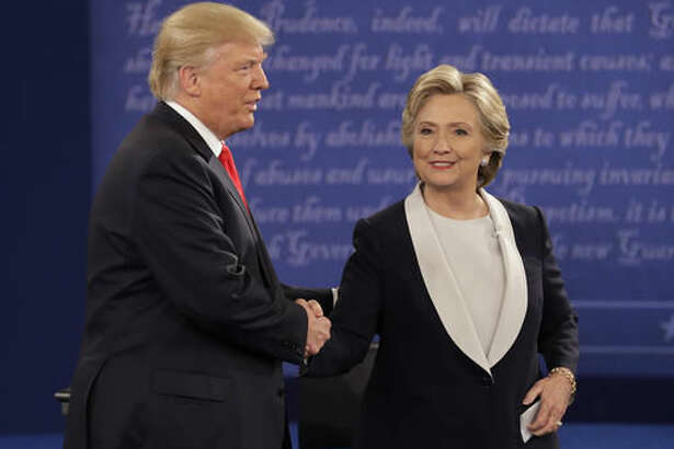 Republican presidential nominee Donald Trump shakes hands with Democratic presidential nominee Hillary Clinton during the second presidential debate at Washington University in St. Louis, Sunday, Oct. 9, 2016. (AP Photo/John Locher)