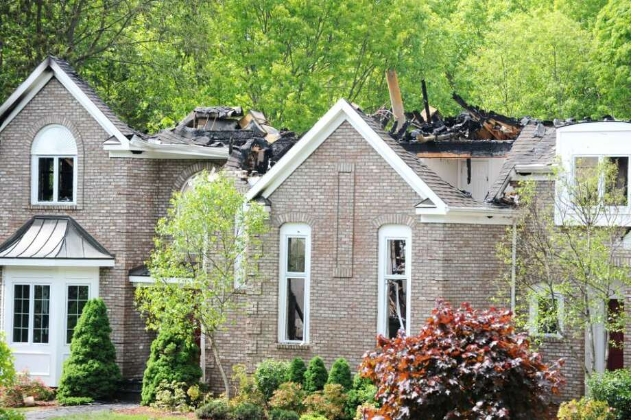 Fire destroyed a home at 68 Deep Valley Trail in Stamford, Conn. on Monday May 10, 2010. Photo: Kathleen O'Rourke / Stamford Advocate