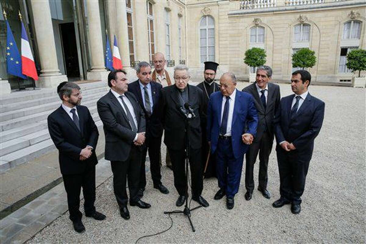 From left to right : France's Chief Rabbi Haim Korsia, French Jewish central Consistory President, Joel Mergui, President of Protestant Federation of France, Pastor Francois Clavairoly, President of the French Buddhist Union, Olivier Reigen Wang-Genh, French Cardinal, Andre Vingt-Trois, General Vicar of the Greek Orthodox metropolis, Grigorios Ioannidis, rector of the Great Mosque of Paris, Dalil Boubakeur, Boubakeur's aid and the vice-president of the French Council of The Muslim Faith, Ahmet Ogras, adresss the media after a meeting with French President, Francois Hollande, following yesterday attack at a church in Normandy, Wednesday, July 27, 2016. The Islamic State group crossed a new threshold Tuesday in its war against the West, as two of its followers targeted a church in Normandy, slitting the throat of an elderly priest celebrating Mass and using hostages as human shields before being shot by police. (AP Photo/Thomas Padilla)