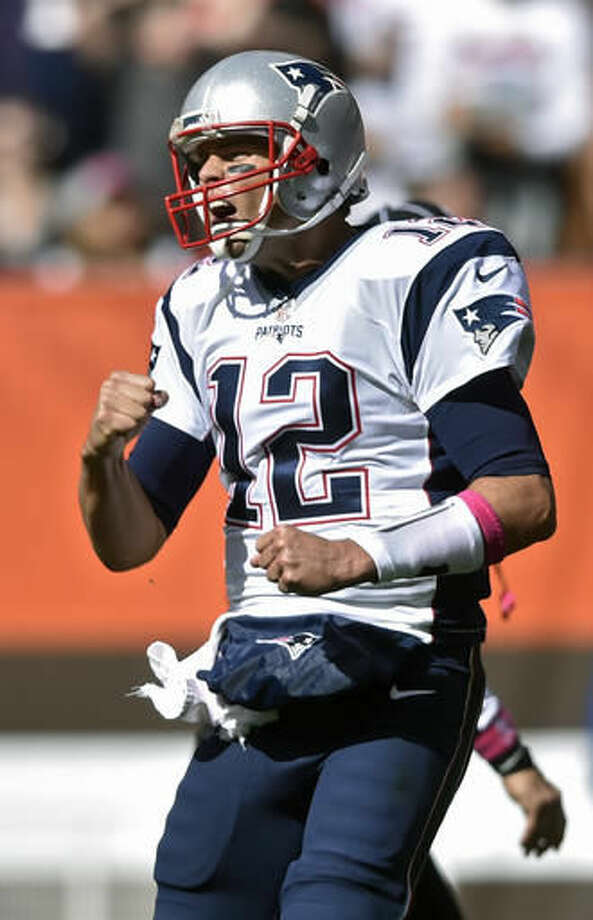 New England Patriots quarterback Tom Brady celebrates a touchdown in the first half of an NFL football game against the Cleveland Browns, Sunday, Oct. 9, 2016, in Cleveland. (AP Photo/David Richard) Photo: David Richard