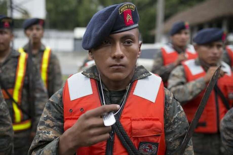 Guatemalan army soldiers stand for review at their base before the arrival of Hurricane Earl, in Puerto Barrios, Guatemala, Tuesday, Aug. 3, 2016. Hurricane Earl bore down on the coast of the Caribbean nation of Belize with the danger of high surf and winds, while also threatening neighboring Guatemala and southern Mexico with torrential rains. (AP Photo/Luis Soto) Photo: Luis Soto