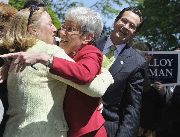 Former Stamford Mayor and Democratic gubernatorial candidate Dan Malloy, right, looks on as State Comptroller Nancy Wyman, center, hugs Malloy's wife, Cathy, as they arrive at the Capitol in Hartford, Conn., Tuesday, May 11, 2010. Malloy has tapped Wyman as his running mate. (AP Photo/Jessica Hill) Photo: Jessica Hill, AP / AP2010