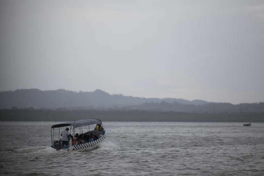 A passenger boat leaves the municipal pier heading to neighboring communities before the arrival of Hurricane Earl, in Puerto Barrios, Guatemala, Tuesday, Aug. 3, 2016. Hurricane Earl bore down on the coast of the Caribbean nation of Belize with the danger of high surf and winds, while also threatening neighboring Guatemala and southern Mexico with torrential rains. (AP Photo/Luis Soto) Photo: Luis Soto
