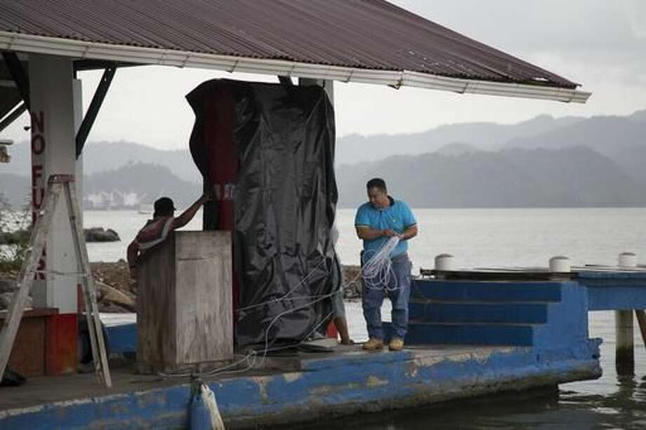 A marine gas station is shut down as it prepares for the arrival of Hurricane Earl, in Puerto Barrios, Guatemala, Tuesday, Aug. 3, 2016. Hurricane Earl bore down on the coast of the Caribbean nation of Belize with the danger of high surf and winds, while also threatening neighboring Guatemala and southern Mexico with torrential rains. (AP Photo/Luis Soto) Photo: Luis Soto