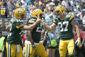 Green Bay Packers quarterback Aaron Rodgers celebrates his touchdown run against the Jacksonville Jaguars with wide receiver Jordy Nelson (87) during the first half of an NFL football game in Jacksonville, Fla., Sunday, Sept. 11, 2016.(AP Photo/Phelan M. Ebenhack)
