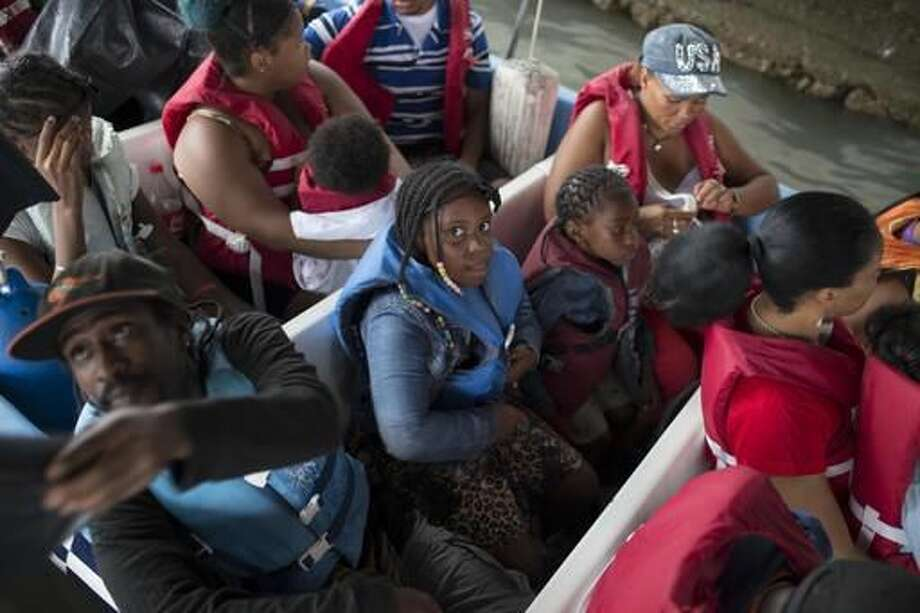 Passengers depart aboard a motor boat transport for the coastal town of Livingston before the arrival of Tropical Storm Earl, from a pier in Puerto Barrios, Guatemala, Tuesday, Aug. 3, 2016. Hurricane Earl bore down on the coast of the Caribbean nation of Belize with the danger of high surf and winds, while also threatening neighboring Guatemala and southern Mexico with torrential rains. (AP Photo/Luis Soto) Photo: Luis Soto