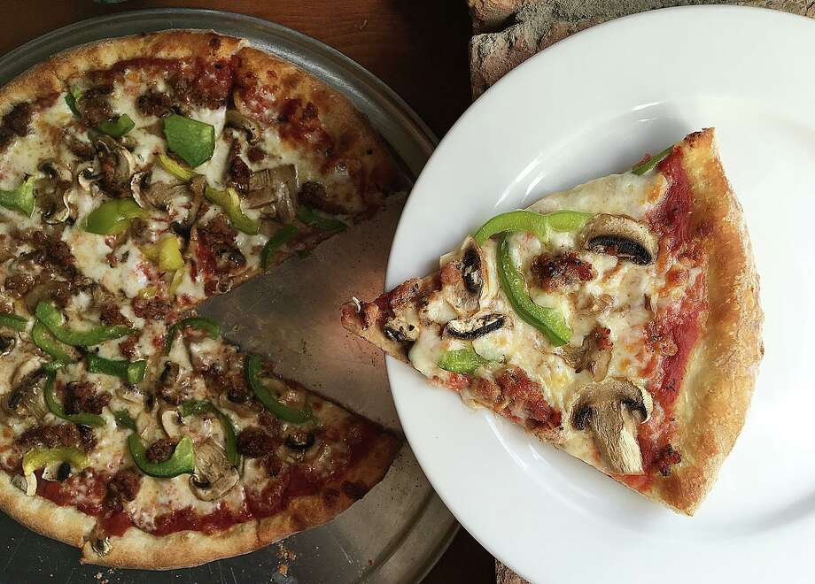 A 14-inch pizza with sausage, mushrooms and green bell pepper on a hand-tossed crust from Southtown Pizzeria. Photo: Mike Sutter /Express-News