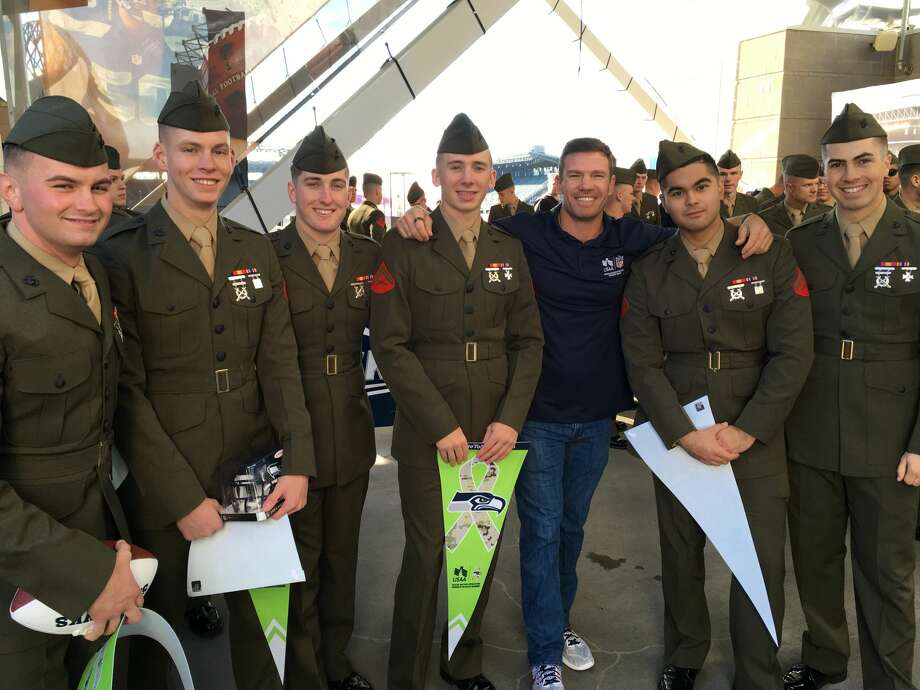 "Former Seahawks player Nate Boyer poses with military members during the ""Change of Command"" ceremony at CenturyLink Field in Seattle on Oct. 11, 2016. Photo: Courtesy USAA"