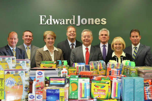 The Edward Jones offices of Midland recently completed their fourth annual school supply drive. The office staff, along with their clients, collected school supplies to be distributed to Elementary Schools in Midland County. Each years' distribution alternates between city and county schools. Pictured are Edward Jones Financial Advisors Jeff Parrish, Adam Thiel, Julie Johnston, Rick Fraser, Wayne Haynes, Dennis Taylor, Mary Lou Myers and Kevin Spencer.