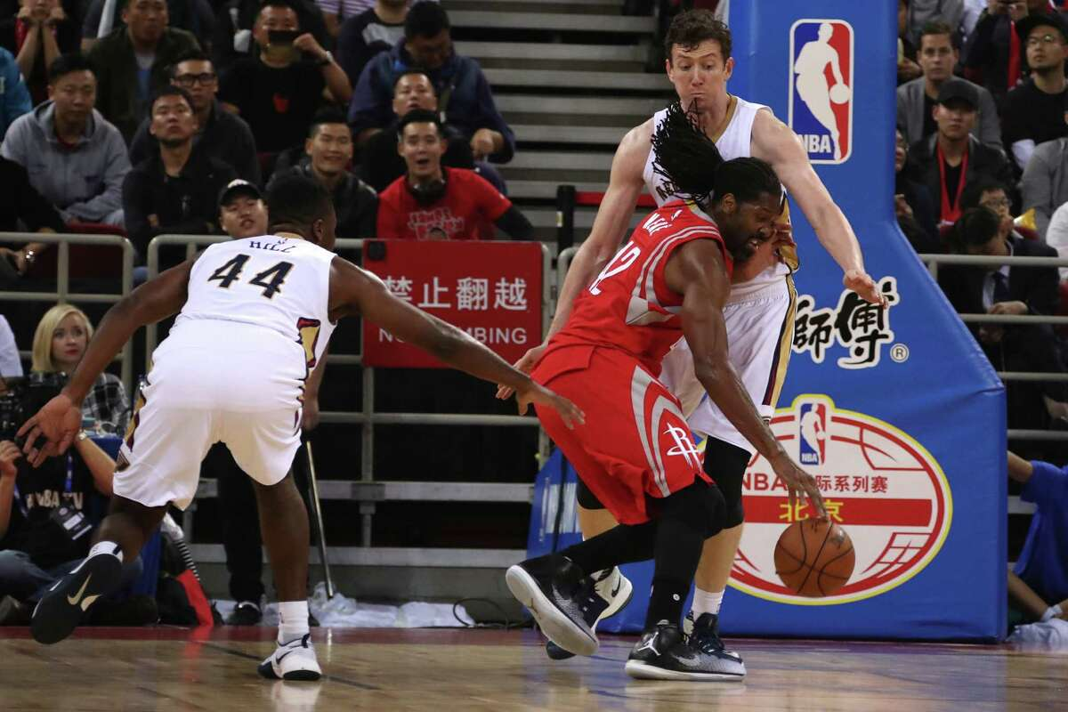 Nene of the Houston Rockets runs into Omer Asik of the New Orleans Pelicans during a preseasons NBA game in Beijing, China, Wednesday, Oct. 12, 2016. (AP Photo/Ng Han Guan)