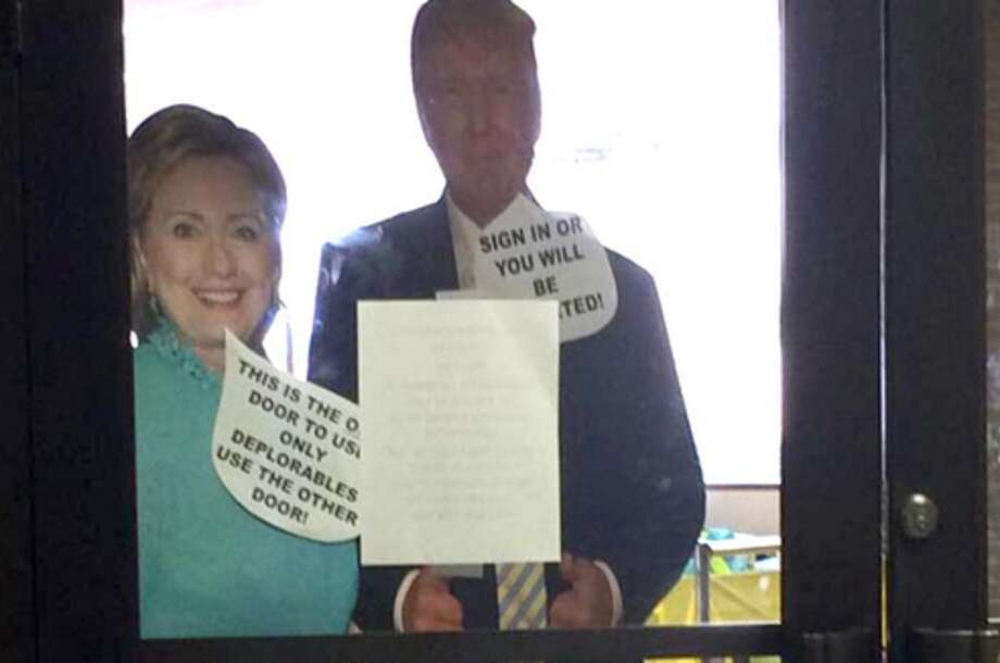 """A Longview High School teacher has been suspended without pay after placing life-size cutouts of both presidential candidates with offensive speech bubbles. The cutouts, which were posted at the school's library entrance on Oct. 4, read """"Sign in or you will be deported"""" and """"This is the only door to use. Only deplorables use the other door.""""Click through to see what Latino singers are saying against Donald Trump."""