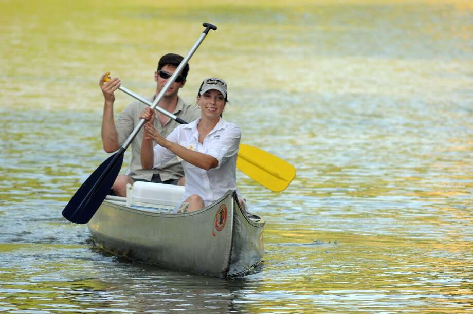 """Ellen Strupp, front, and her husband Chris, of Spring, navigate the waters of Spring Creek during the """"Canoes, the Creek and the Commissioner"""" event at Jesse H. Jones Park and Nature Center on August 22. Members of the Bayou Land Conservancy were invited to join Harris County Precinct 4 Commissioner Jack Cagle in paddling the unique habitats of Spring and Cypress Creek during the event. Photo: Jerry Baker, Freelance"""