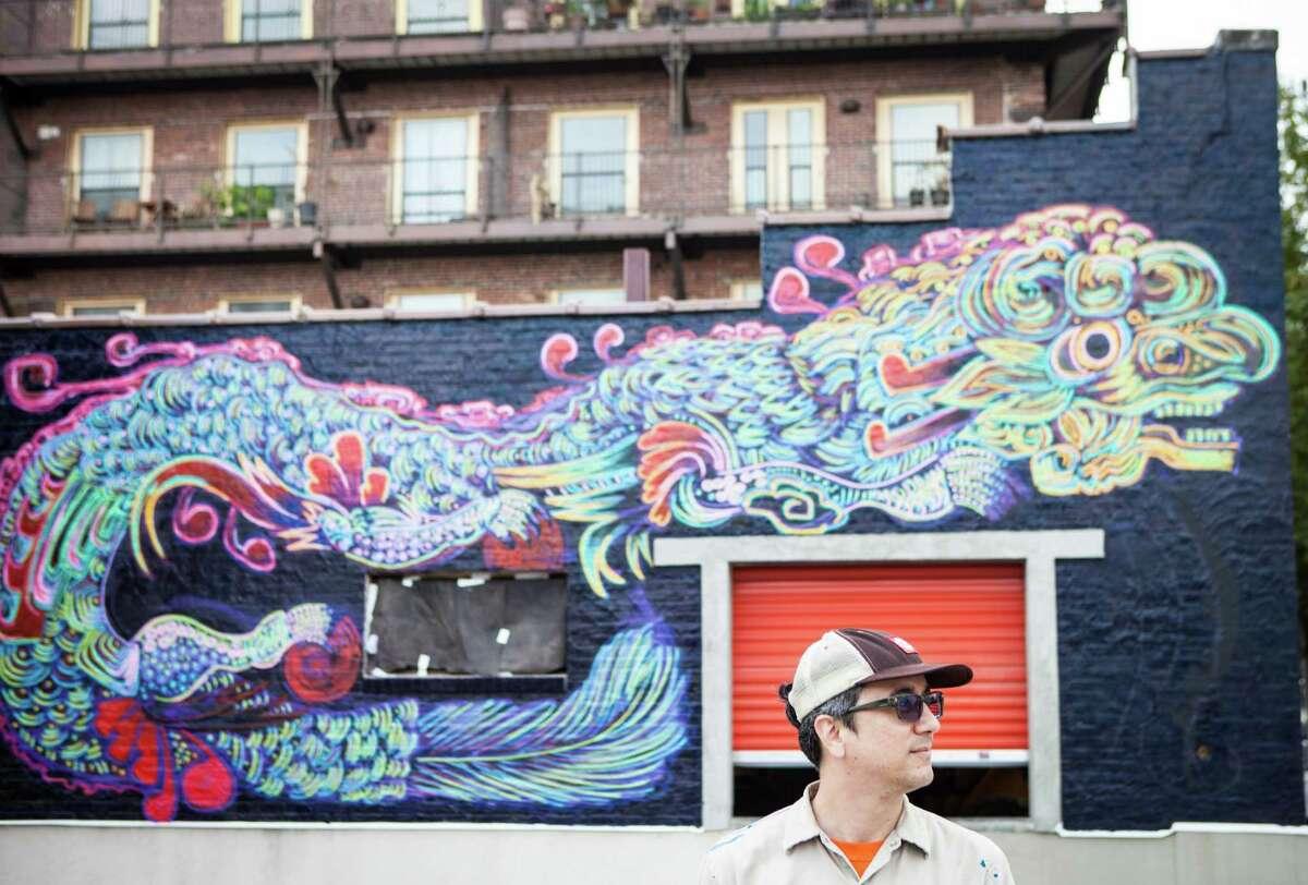Angel Quesada painting a mural for Houston Mural Festival.