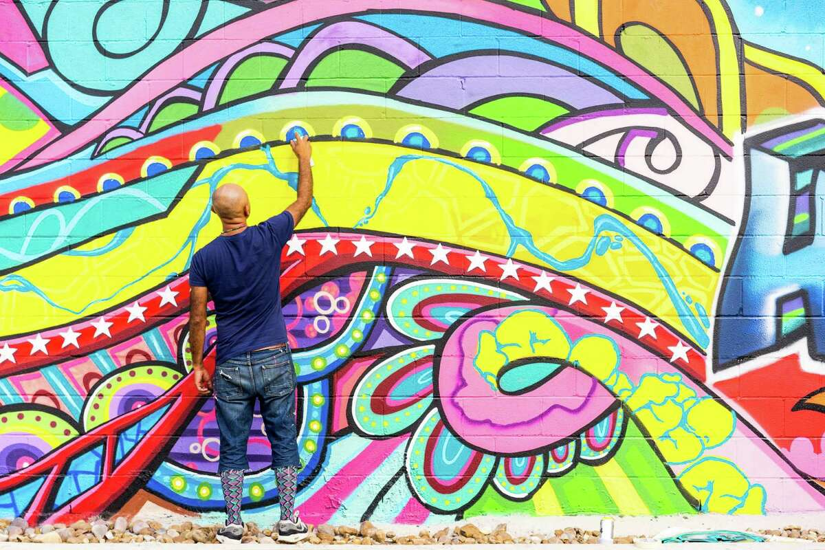 Gonzo is shown working on the large-scale mural he created in Market Square in 2013.