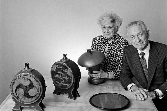 FILE -- Herbert and Florence Irving with items from their collection of lacquerware, in New York, Aug. 8, 1991.  Herbert Irving, a co-founder of the food services giant Sysco Corporation and a philanthropist who donated more than $300 million to NewYork-Presbyterian Hospital/Columbia University Medical Center, died on Oct. 3, 2016, at his home in Manhattan. He was 98. (Fred R. Conrad/The New York Times)