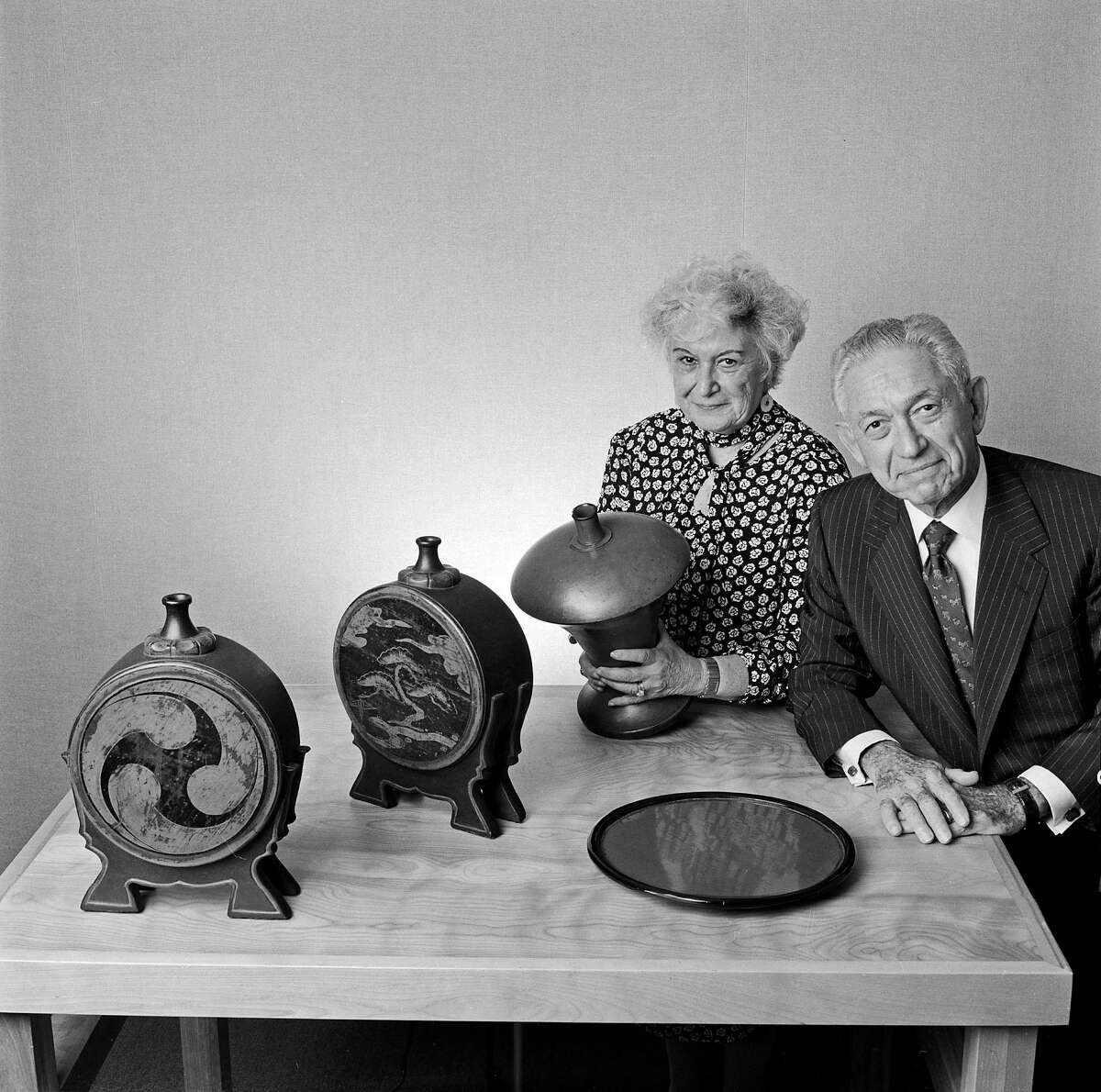 Herbert and Florence Irving with items from their collection of lacquerware in 1991. (Fred R. Conrad/The New York Times)
