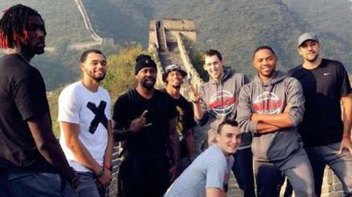 Houston Rockets players pose for a picture at the Great Wall of China.