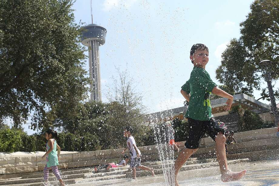 Max Villon, 6, plays in the water features at the Yanaguana Gardens in Hemisfair on Oct. 11, 2015. Temperatures hit the low 90s. Photo: Jerry Lara /San Antonio Express-News / © 2015 San Antonio Express-News