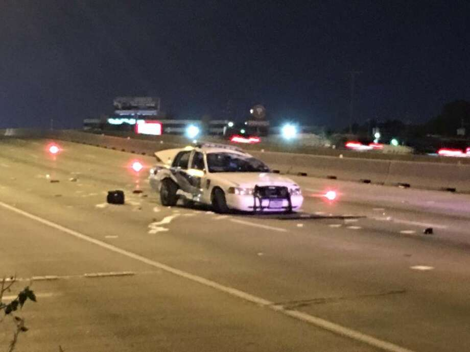 A deputy constable is recovering after a suspect slammed into his patrol car about 11:50 p.m. Saturday, Oct. 8, 2016, in the 7400 block of the North Freeway in north Houston (Harris County Precinct 4 Constable's Office)