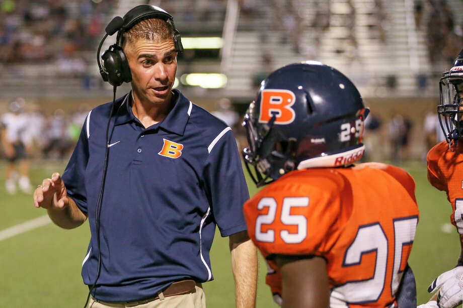 Brandeis coach Jeff Fleener talks to Gary Lee on the sideline during the second half aginst Boerne Champion at Farris Stadium on Sept. 9, 2016. Photo: Marvin Pfeiffer /San Antonio Express-News / Express-News 2016