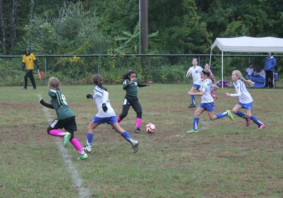 Madeleine Walsh and Annabelle Sterling compete in a New Milford Cosmos game in Bethel. Photo: John Nestor /The Spectrum