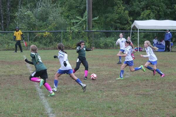 Madeleine Walsh and Annabelle Sterling compete in a New Milford Cosmos game in Bethel.