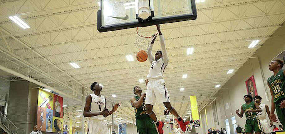 Walter Whyte hangs on the rim after a dunk during an AAU game with the PSA Cardinals. Whyte, a senior at St. Luke's committed to Boston University on Tuesday. Photo: Contributed Photo