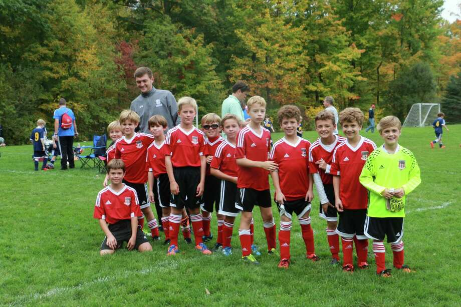 The New Canaan 2008 boys Red team, which went undefeated at the Ridgefield Columbus Day tournament. Players include:Drew Burr, Henry Chandra, Rhett DuPont, Connor Hahn, Tristan MacAllister, Dante Marsili, Christian Puente, John Puente, Matt Reed, Graydon Sieghart, William Tamasco, Lucas Tecklenburg, Will Teles and Teddy Van Dussen. Photo: Contributed Photo