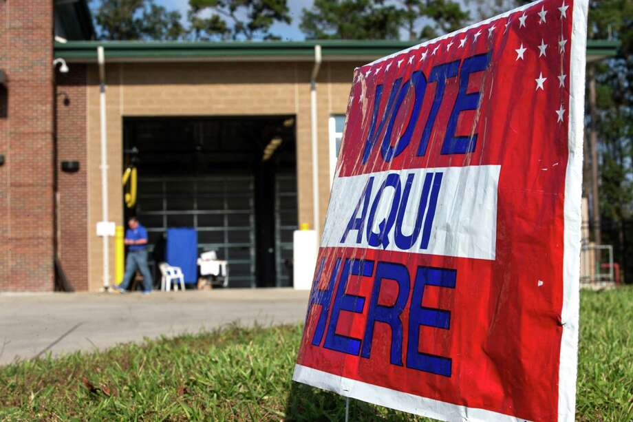 Voters line up to cast their ballots at South Montgomery County Fire Station 4 on Nov. 3, 2015. When Voting Day rolls around this November, a large portion of seniors at Magnolia ISD will be hitting the polls. Under the respective slogans 'There's hope for the vote' at Magnolia West and 'Rock the Vote' at Magnolia High School, the initiative got approximately 200 students in the district to register out of the 300 who will be eligible to vote on Nov. 8. Photo: Brett Coomer, Staff / © 2015 Houston Chronicle