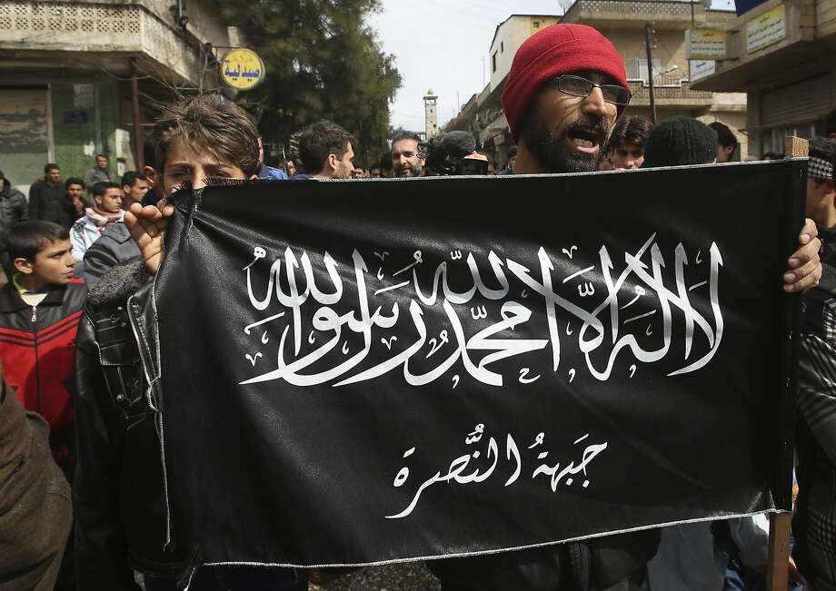Nusra Front members protest in northern Syria in 2013. The group was recently targeted in an attack. Photo: Hussein Malla, Associated Press