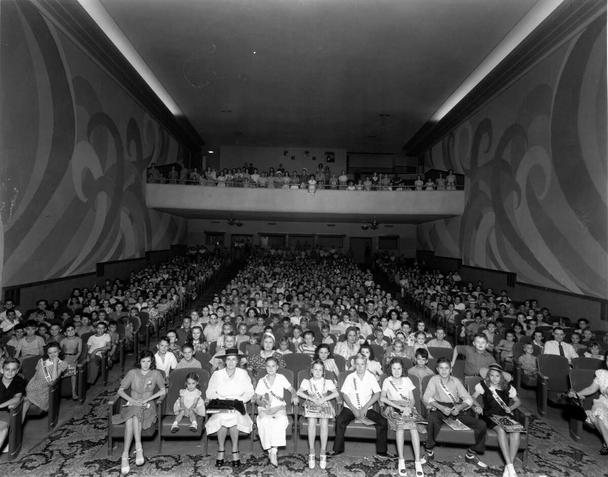 A mostly young crowd fills the 960-seat Village Theatre during its heyday.
