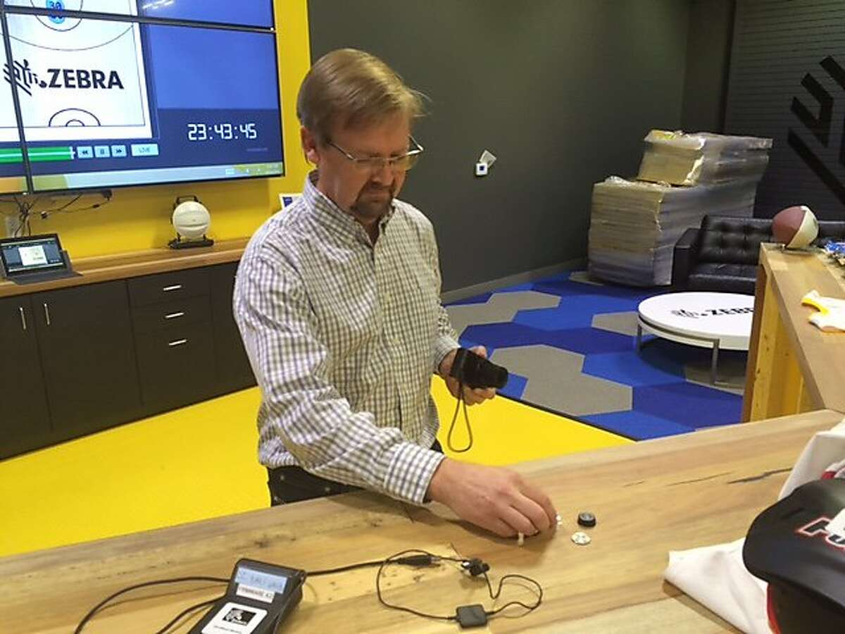 Scott Ard, editor in chief of the Silicon Valley Business Journal, positions RFID sensors for a photo during a press event at Zebra Technologies in San Jose on Friday, Aug. 26, 2016. Zebra Technologies held the event to show off its wireless tracking sensors, which have been placed in the shoulder pads of NFL players and in the shirts of NFL referees. Ard has sued his former employer, Yahoo, accusing CEO Marissa Mayer of discriminating against male employees.