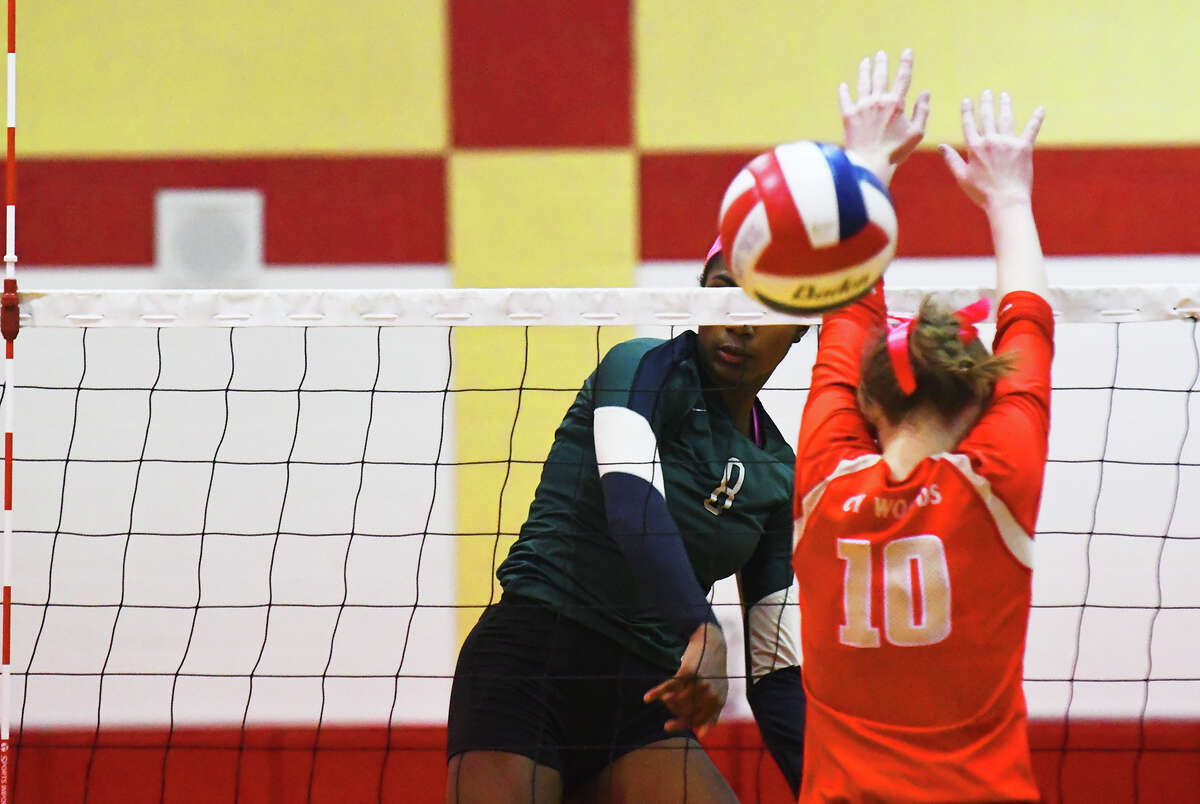 Cy Falls senior outside hitter Yossiana Pressley logs a kill against Cypress Woods Tuesday night. Despite her team's struggles, Yossi enjoyed a strong outing, finishing with 16 kills, three solo blocks and 16 digs.