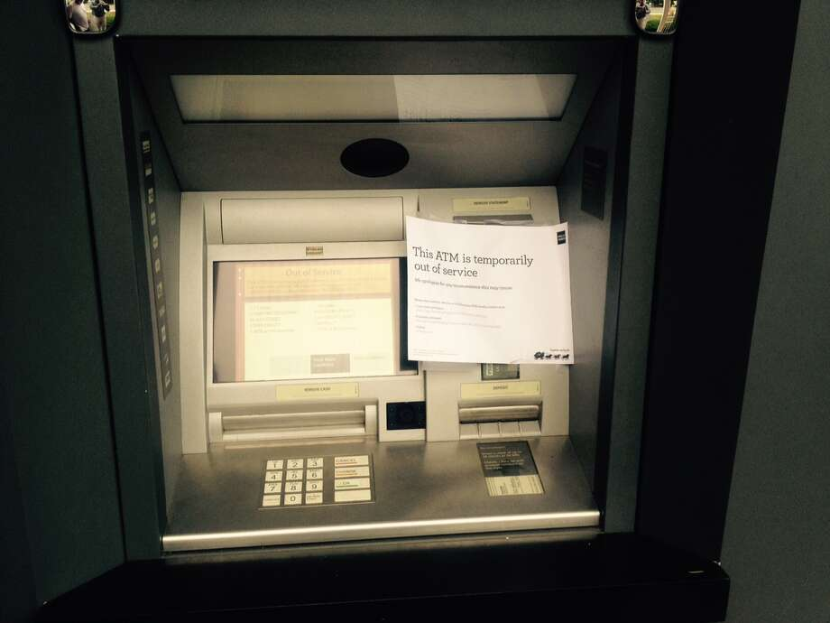 This ATM at Wells Fargo on Hope Street in Glenbrook was taken out of service after a skimming device was found on the ATM Tuesday night. Photo: John Nickerson / Staff Photo