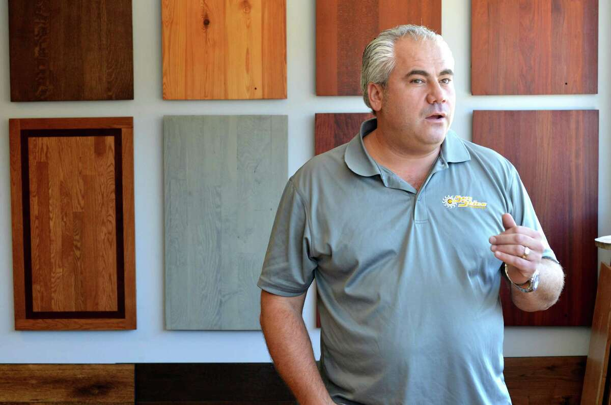 Razan Tata, CEO of SunShine Floors stands in his new Norwalk Conn. showroom with samples of the different types of wood and finishes available for new hardwood floors, on Tuesday October 11, 2016.