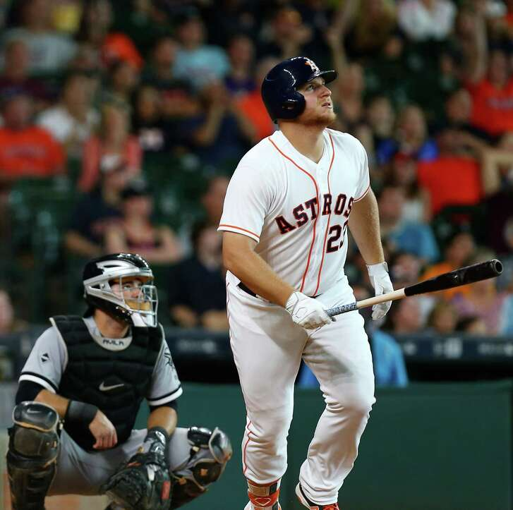 Houston Astros first baseman A.J. Reed (23) watches his home run, the first of his major league career, go over the outfield wall during the ninth inning of an MLB game at Minute Maid Park, Saturday, July 2, 2016, in Houston.  ( Jon Shapley / Houston Chronicle )