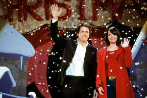 """The Prime Minister (Hugh Grant) and Natalie (Martine McCutcheon) are caught off-guard (and quite by accident) at a Christmas pageant in Richard Curtis's romantic comedy Love Actually.""""Peter Mountain /"""