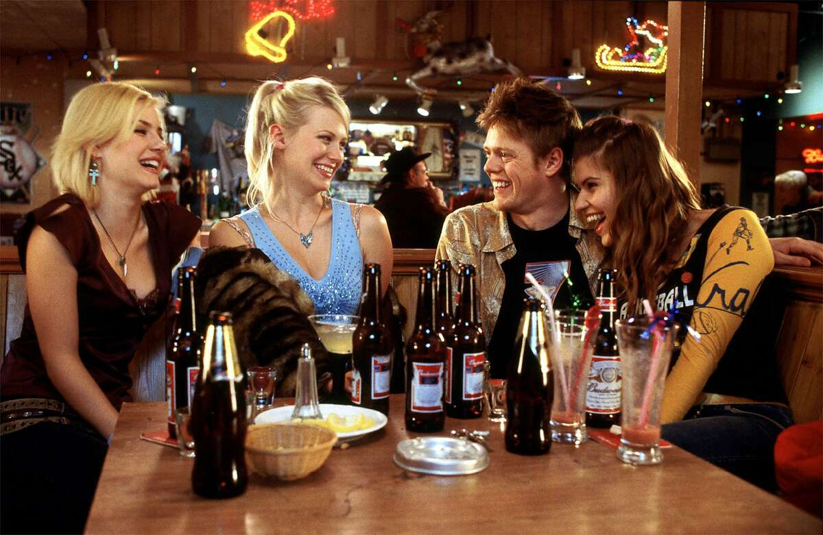 Carol Anne (Elisha Cuthbert), Jeannie (January Jones), Colin (Kris Marshall) and Stacy (Ivana Milicevic) combat the Milwaukee cold with a little hot conversation in Richard Curtis's romantic comedy
