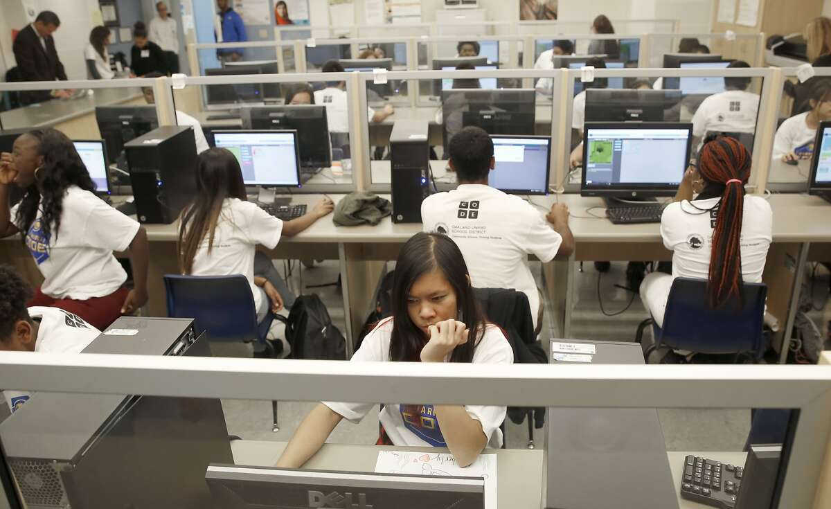 Eleventh grader Kimberly Vong (middle), 15 years old, learns to code at the science center at Oakland High School on Wednesday, October 12, 2016, in Oakland, Calif.