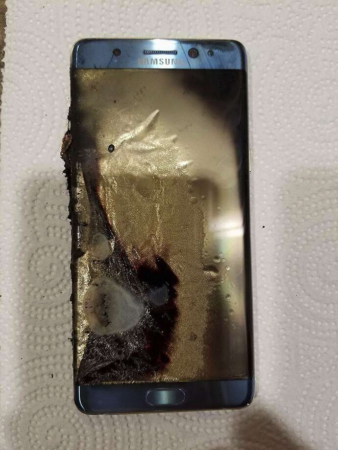 This Sept. 8, 2016, photo, shows a damaged Samsung Galaxy Note 7, in Marion, Ill., belonging to Joni Gantz Barwick, who was woken up at 3 a.m. by smoke and sparks from her Galaxy Note 7. Her nightstand and bed sheets were burnt. Consumers from Shanghai to New York are left wondering about Samsung's smartphone brand after the South Korean tech giant recalled the devices, and then recalled their replacements, too. (Joni Gantz Barwick via AP) Photo: Joni Gantz Barwick, Associated Press