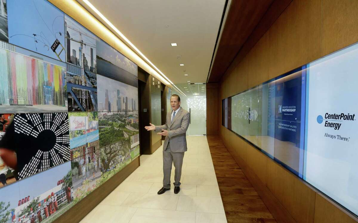 Jamey Rootes, chairman Greater Houston Partnership, talks about their new office building at 701 Avenida De Las Americas shown Tuesday, Oct. 11, 2016, in Houston. The entrance includes a video wall and massive photo display wall.